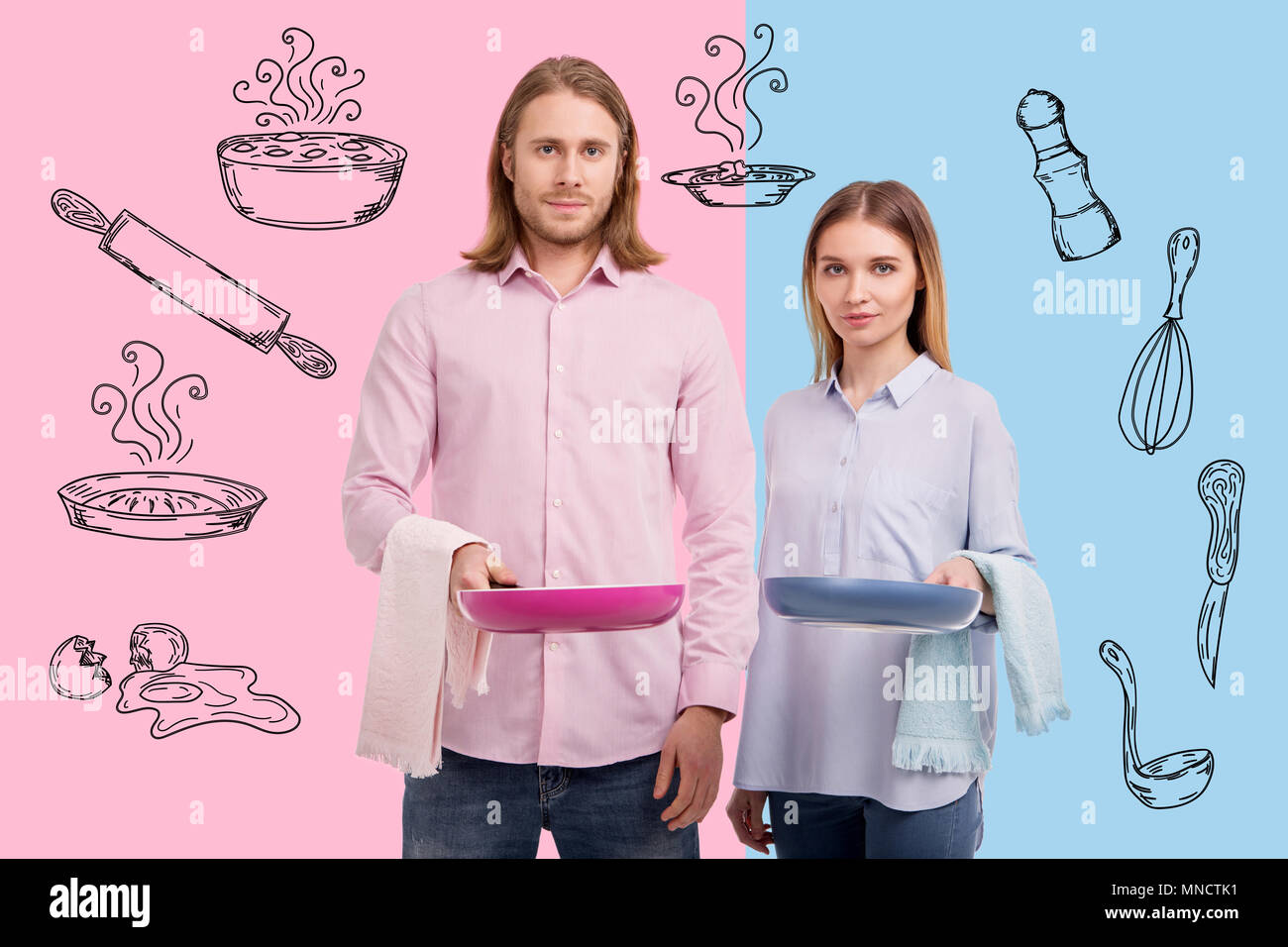 Waist up of young cheerful couple cooking breakfast - Stock Image