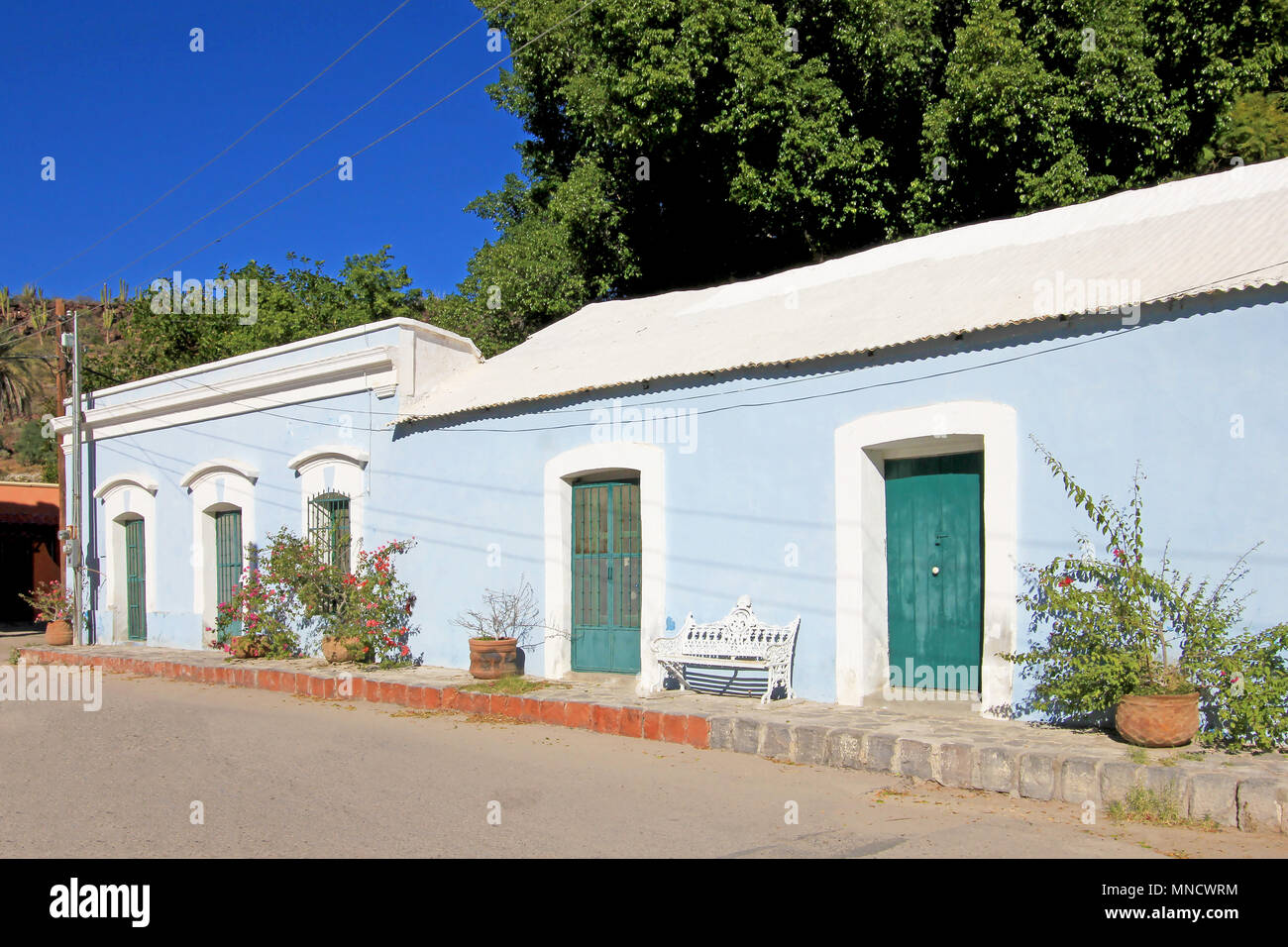 Colorful traditional houses in the streets of the Mission San Ignacio, Baja California, Mexico - Stock Image