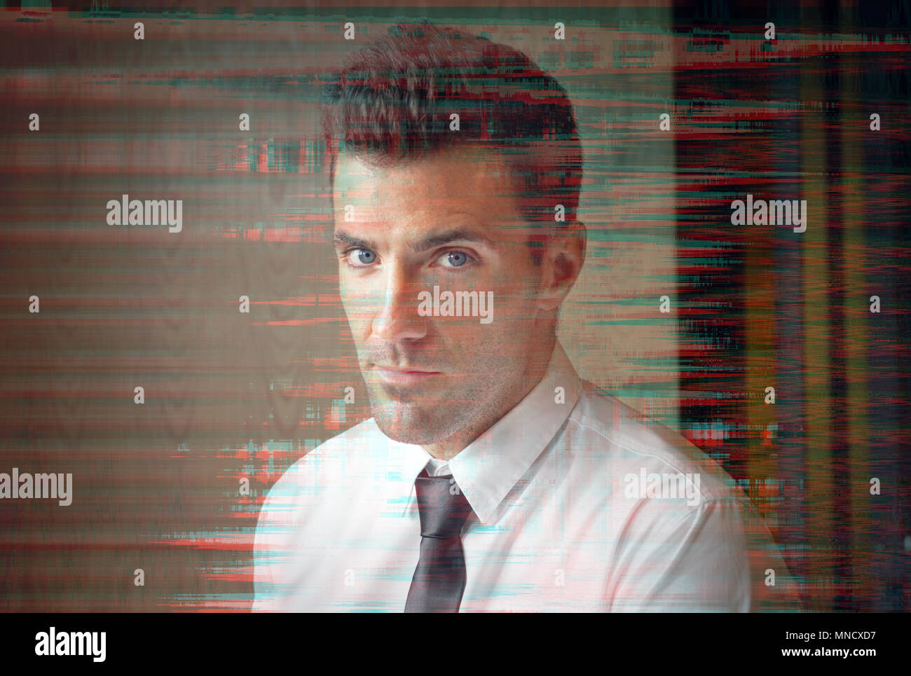 Young confident businessman with beautiful blue eyes staring at
