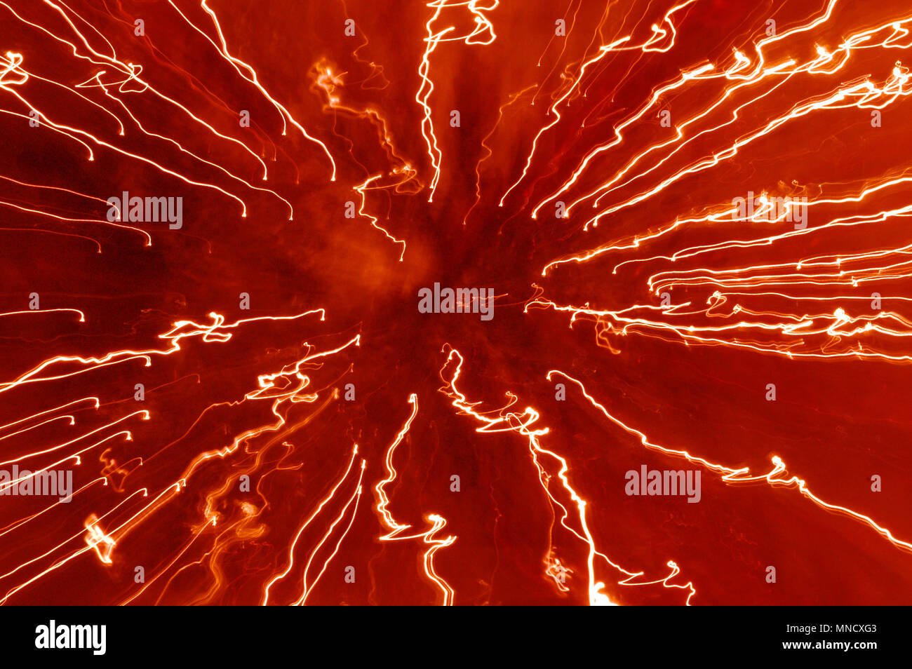 LONDON, ENGLAND - JANUARY 4 : Abstract hot red streaking white lights of zooming light trails. January 6, 2006. United Kingdom. - Stock Image