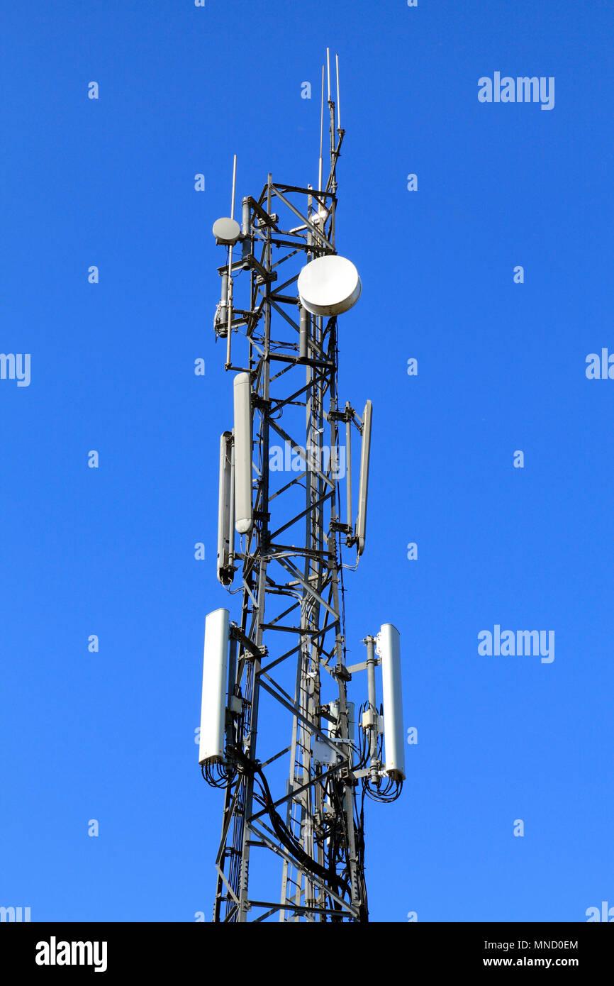 Communications mast, tower, signals, satellite dish, radio, Hunstanton Police Station, Norfolk, England, UK - Stock Image