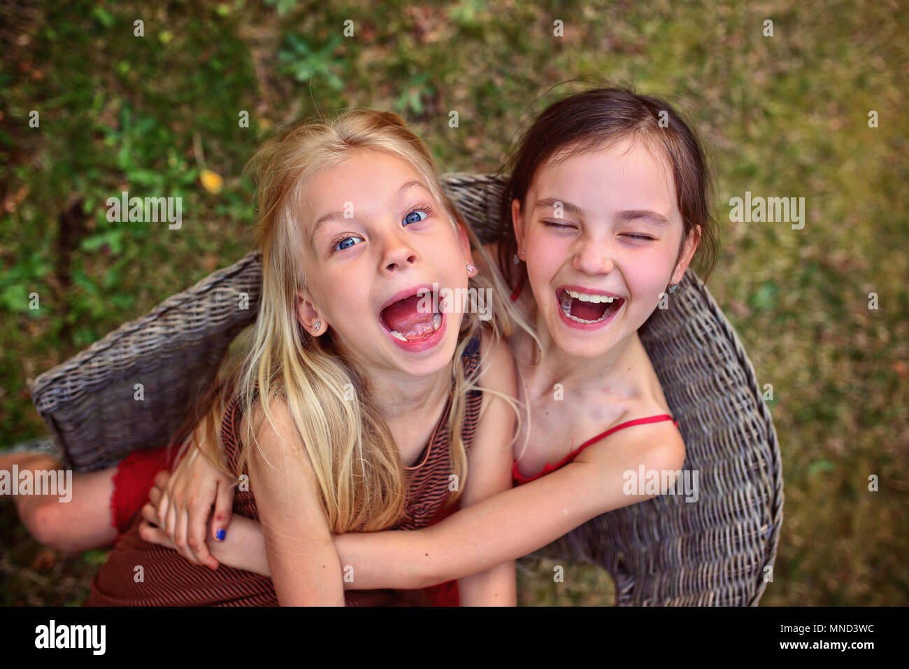 happy girls laugh and cuddle Stock Photo