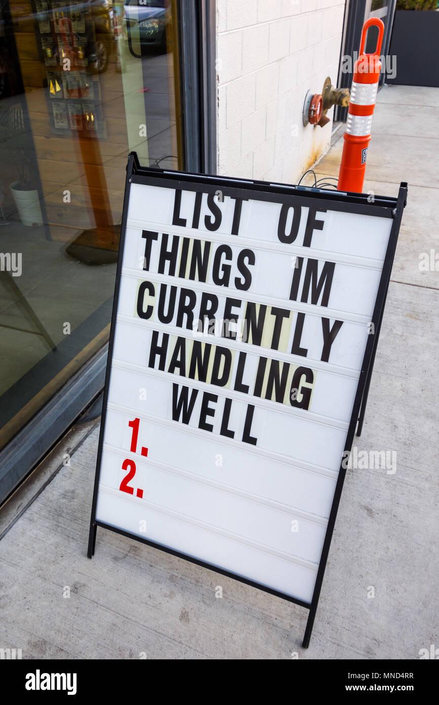 Optimistic / pessimistic sign on street, Denver, Colorado, USA. - Stock Image