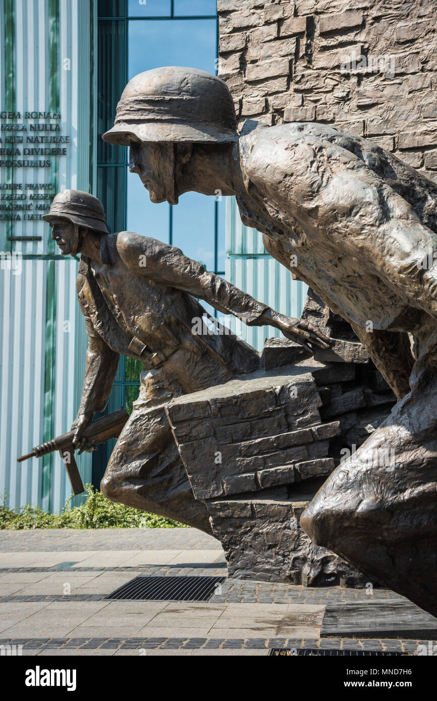 Detail of two Polish resistance fighters portrayed in the Monument To The Warsaw Rising in Plac Krasinskich in the center of Warsaw, Poland. Stock Photo