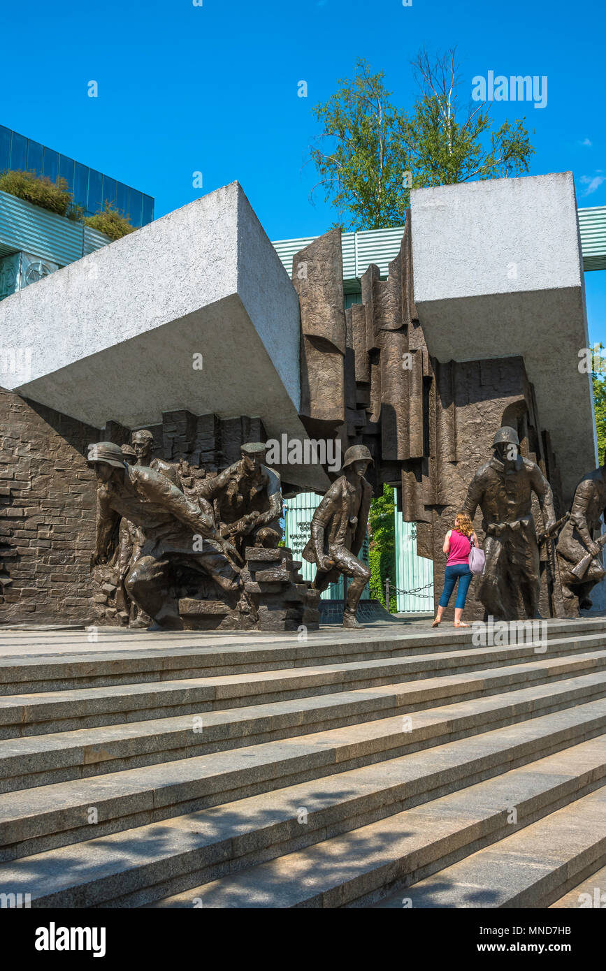 View of a woman looking at the Monument To The Warsaw Rising in Plac Krasinskich in the center of Warsaw, Poland. - Stock Image