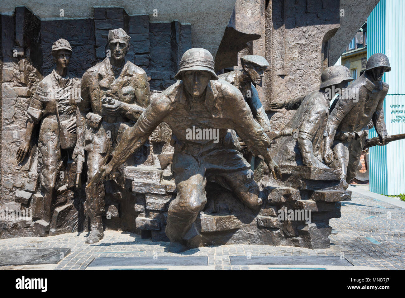 Detail of Polish resistance fighters portrayed in the Monument To The Warsaw Rising in Plac Krasinskich in the center of Warsaw, Poland. Stock Photo
