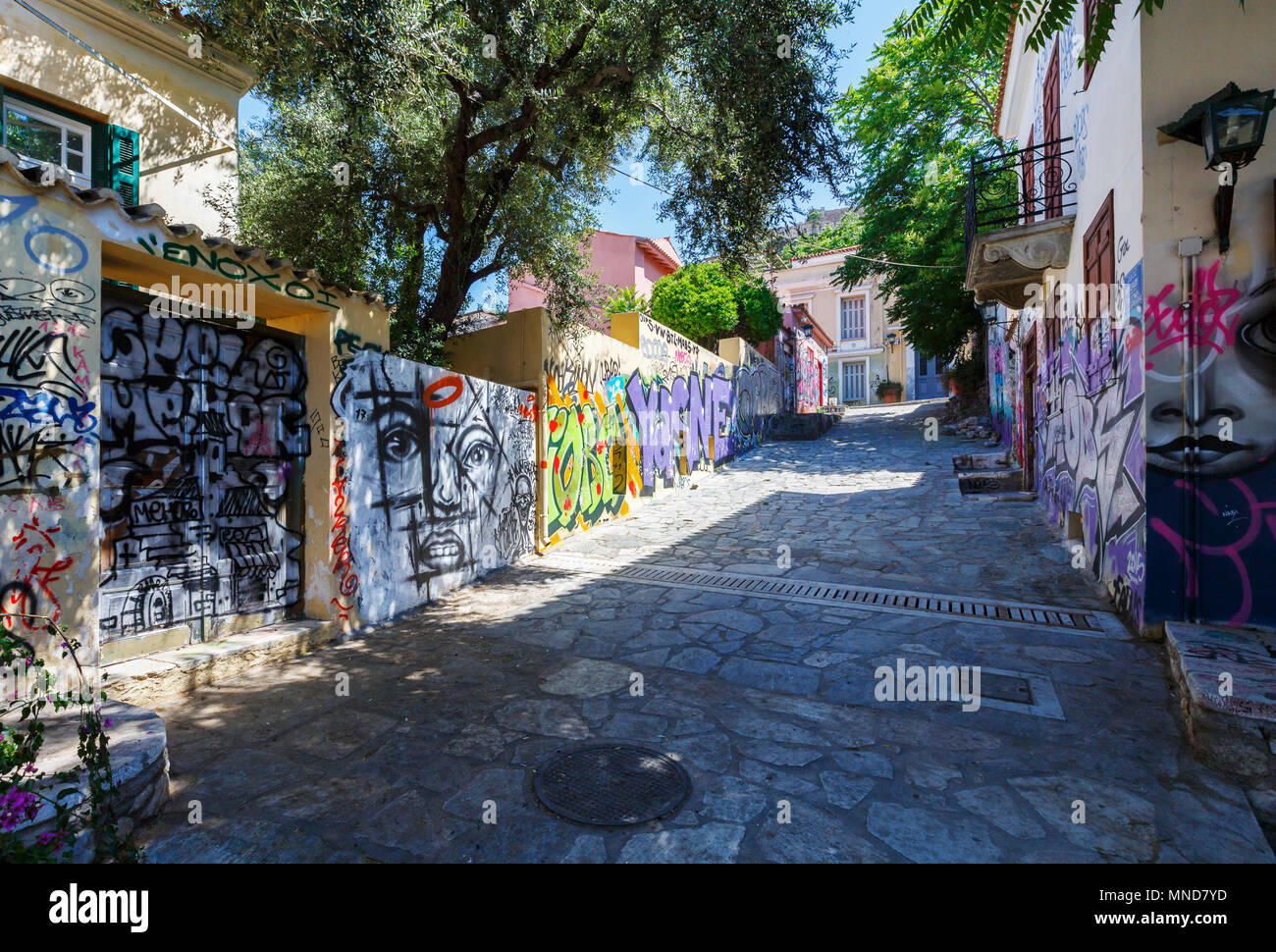 Athens, Greece - May 14, 2018: Plaka, the old town of Athens, is known for its ancient sites and charming neoclassical buildings however it also has i - Stock Image