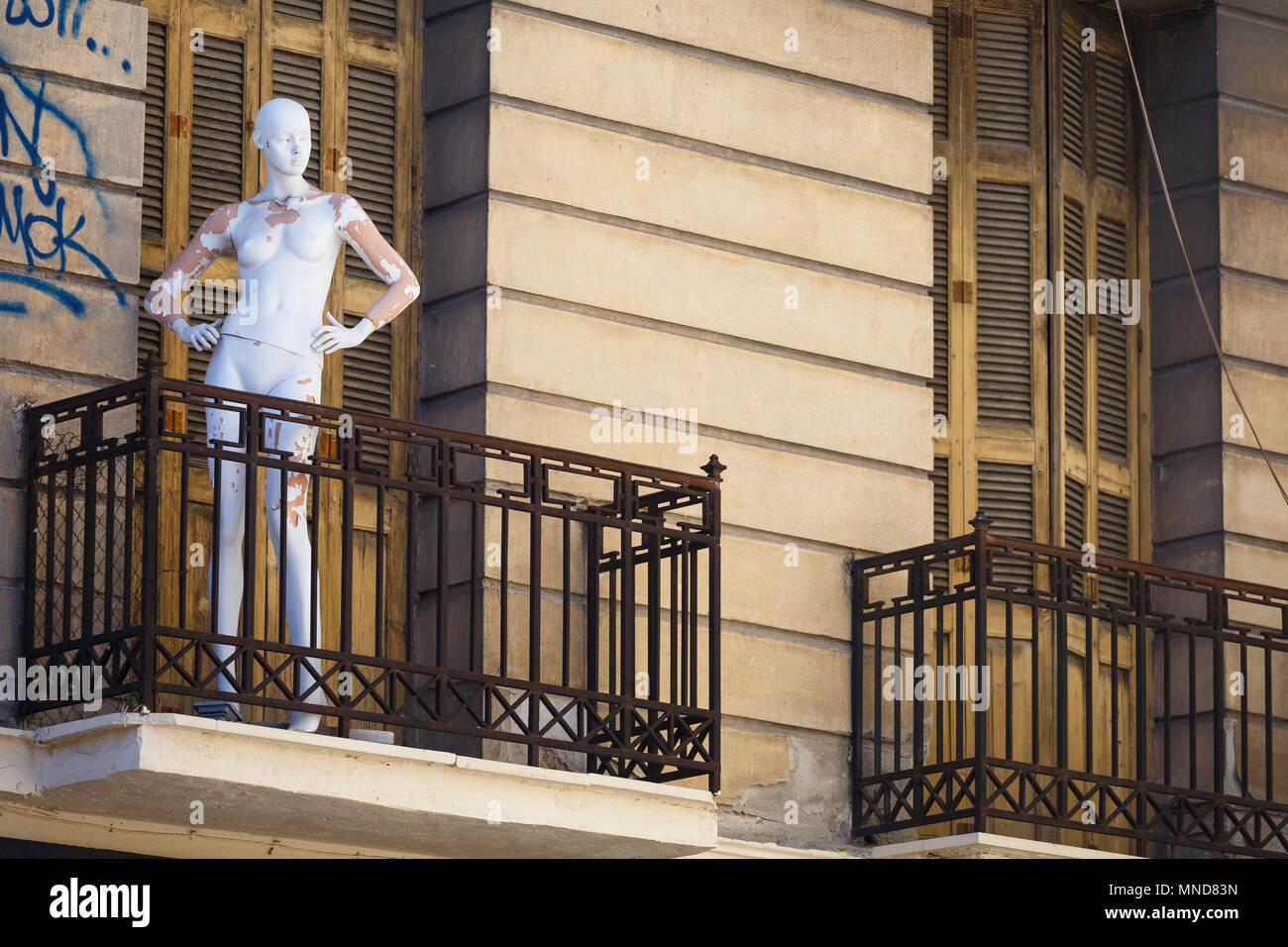 Athens, Greece - May 14, 2018: Disused mannequin on a balcony of an abandoned neoclassical building in the historical centre of Athens city. - Stock Image