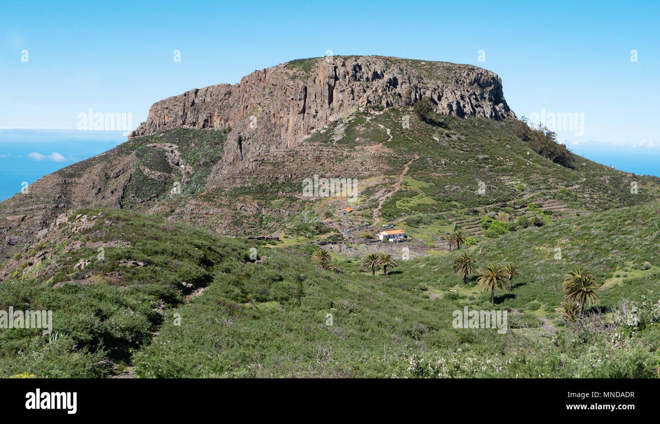 The Fortaleza de Chipude a massive volcanic plug and natural fortress overlooking the western coast of La Gomera in the Canary Islands - Stock Image