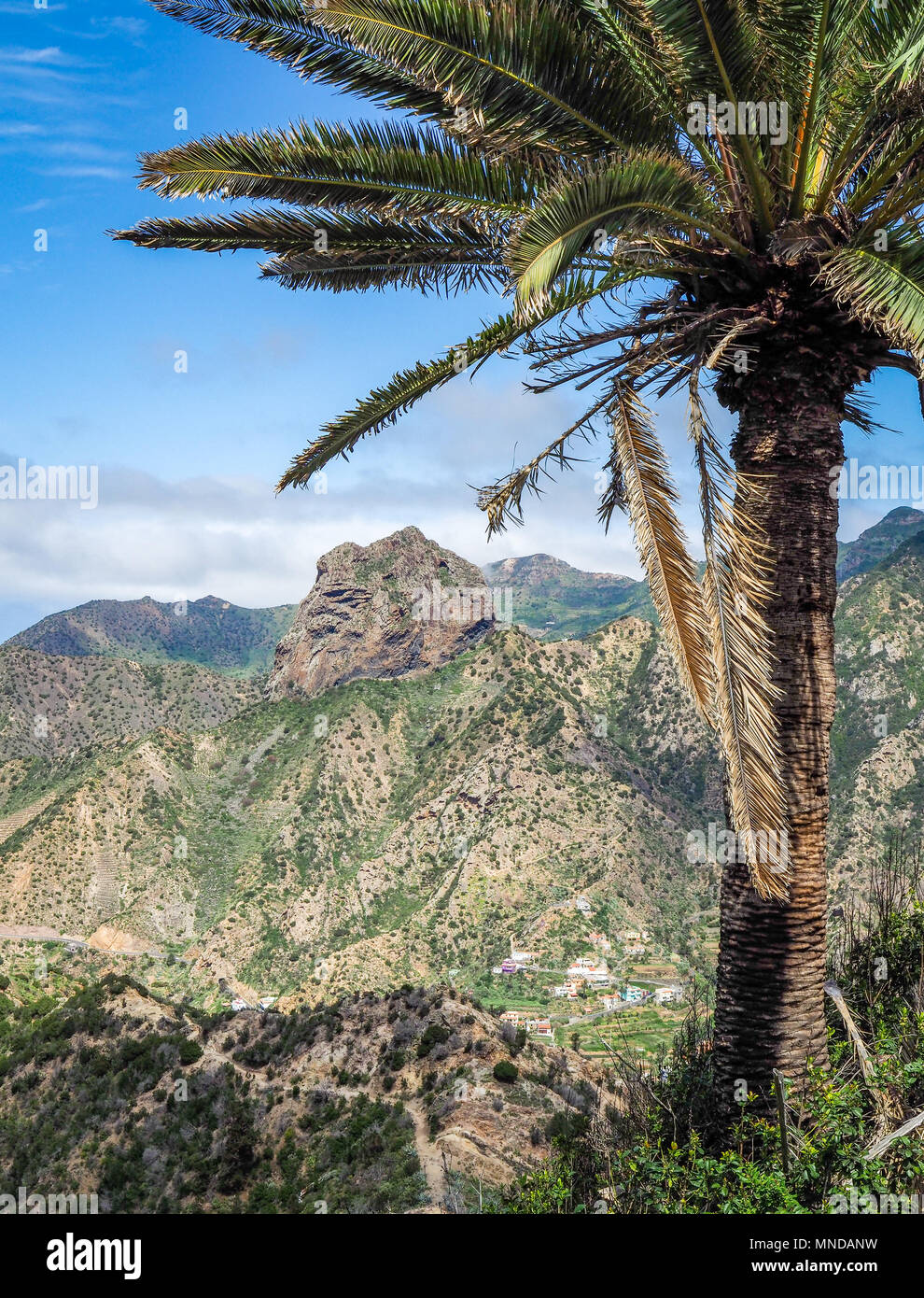 Trail down to the town of Vallehermoso dominated by the Roque el Cano in the north of La Gomera in the Canary Islands - Stock Image