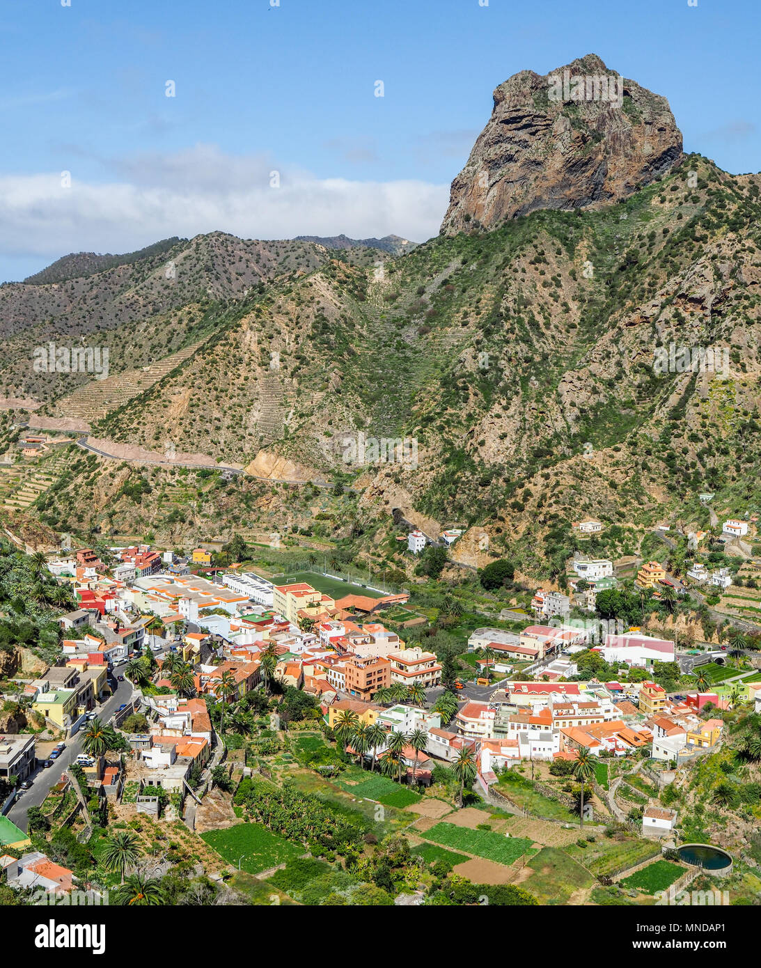 Looking down on the town of Vallehermoso dominated by the Roque el Cano in the north of La Gomera in the Canary Islands - Stock Image