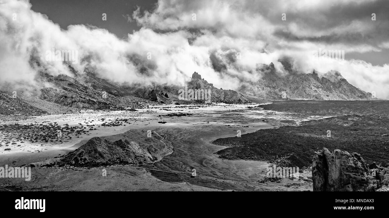 Monochrome view of the Plane of Ucanca and mountains of the crater rim on Mount Teide or Pico del Teide an active volcano on Tenerife Canary Islands Stock Photo