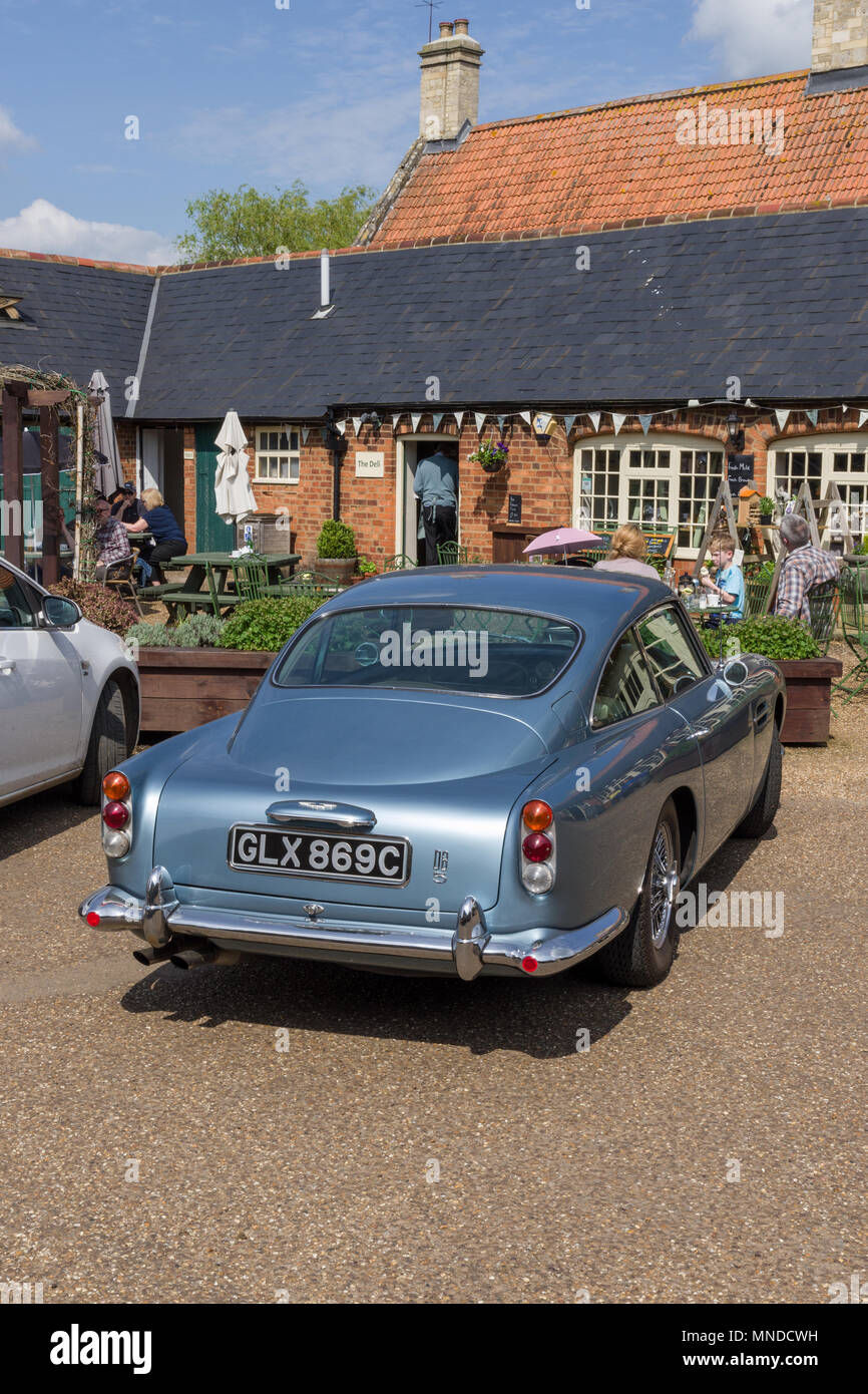 Aston Martin DB5 in light blue, a British design classic, perhaps best known for it's James Bond connection. - Stock Image