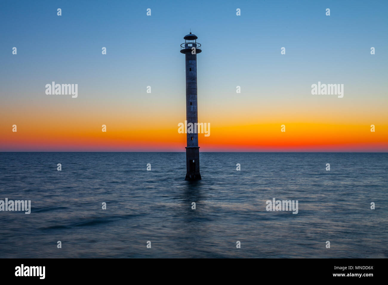 Skew lighthouse in the Baltic Sea. Late sunset time. Kiipsaare, Harilaid, Saaremaa, Estonia, Europe. - Stock Image