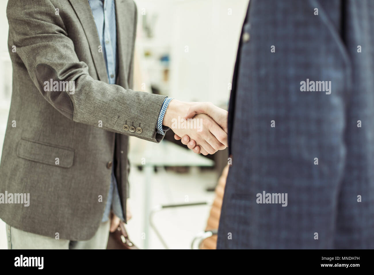 handshake of business partners before starting the discussion of a new Treaty - Stock Image