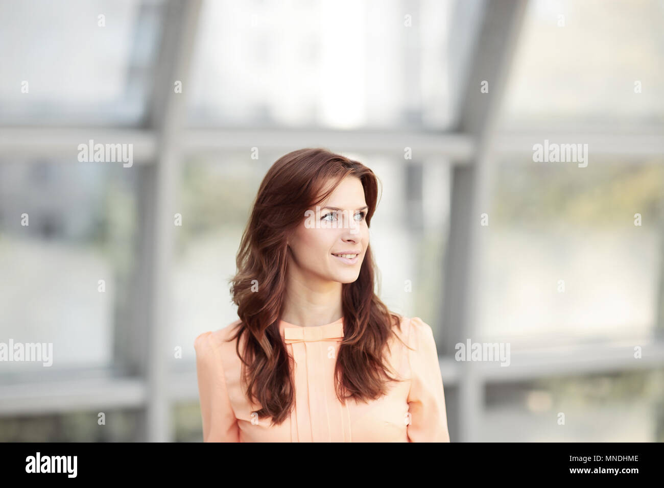 close up.portrait of modern young woman on blurred office background. - Stock Image