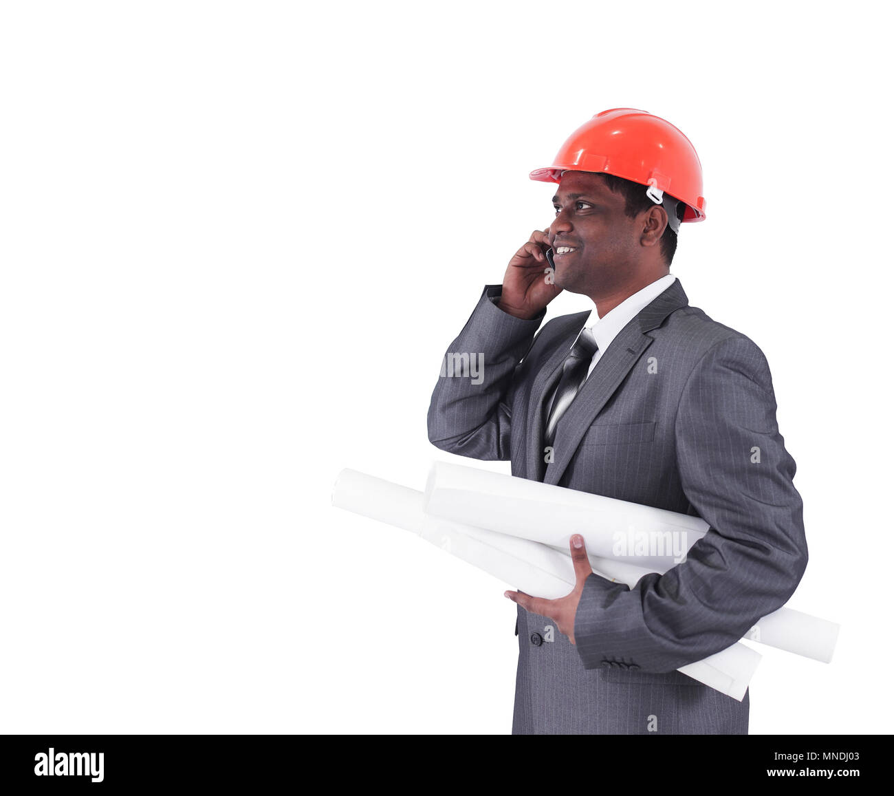 handsome engineer architect talking on mobile phone - Stock Image