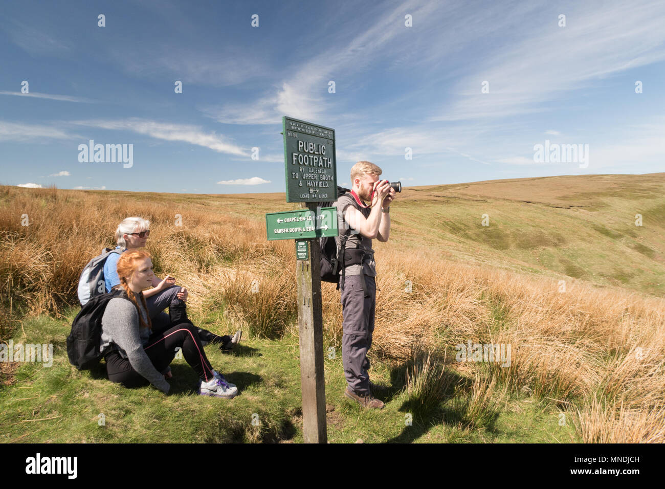 Walkers above the Edale valley in the Peak District - Stock Image