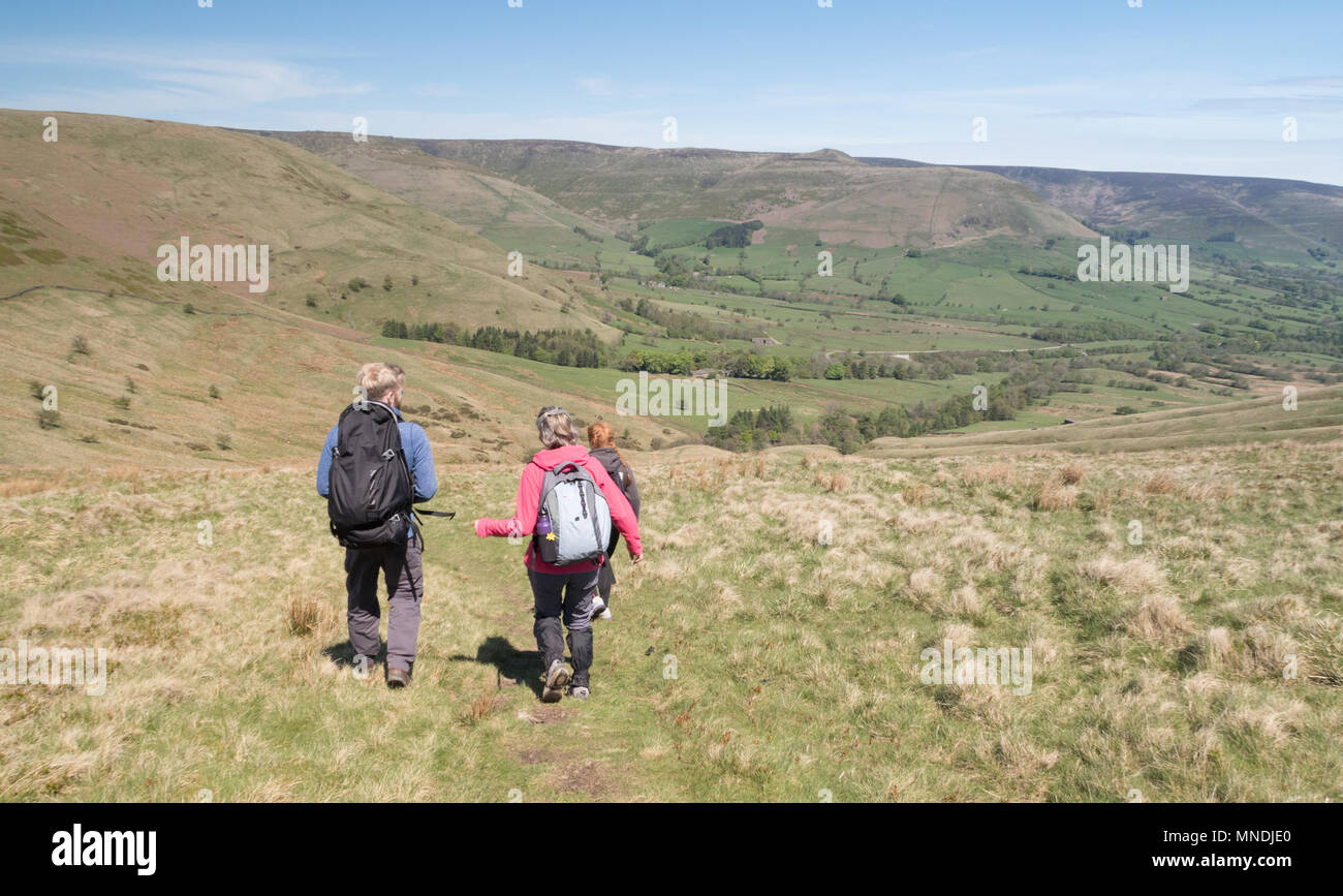 Walkers above the Edale valley in tghe Peak District - Stock Image