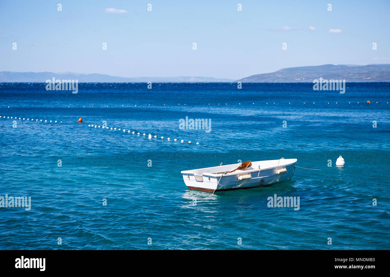 Small water craft drifting in the deep blue sea Beautiful