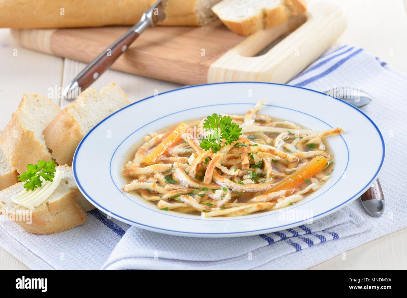 German soup: Beef bouillon with chopped pancakes - Stock Image