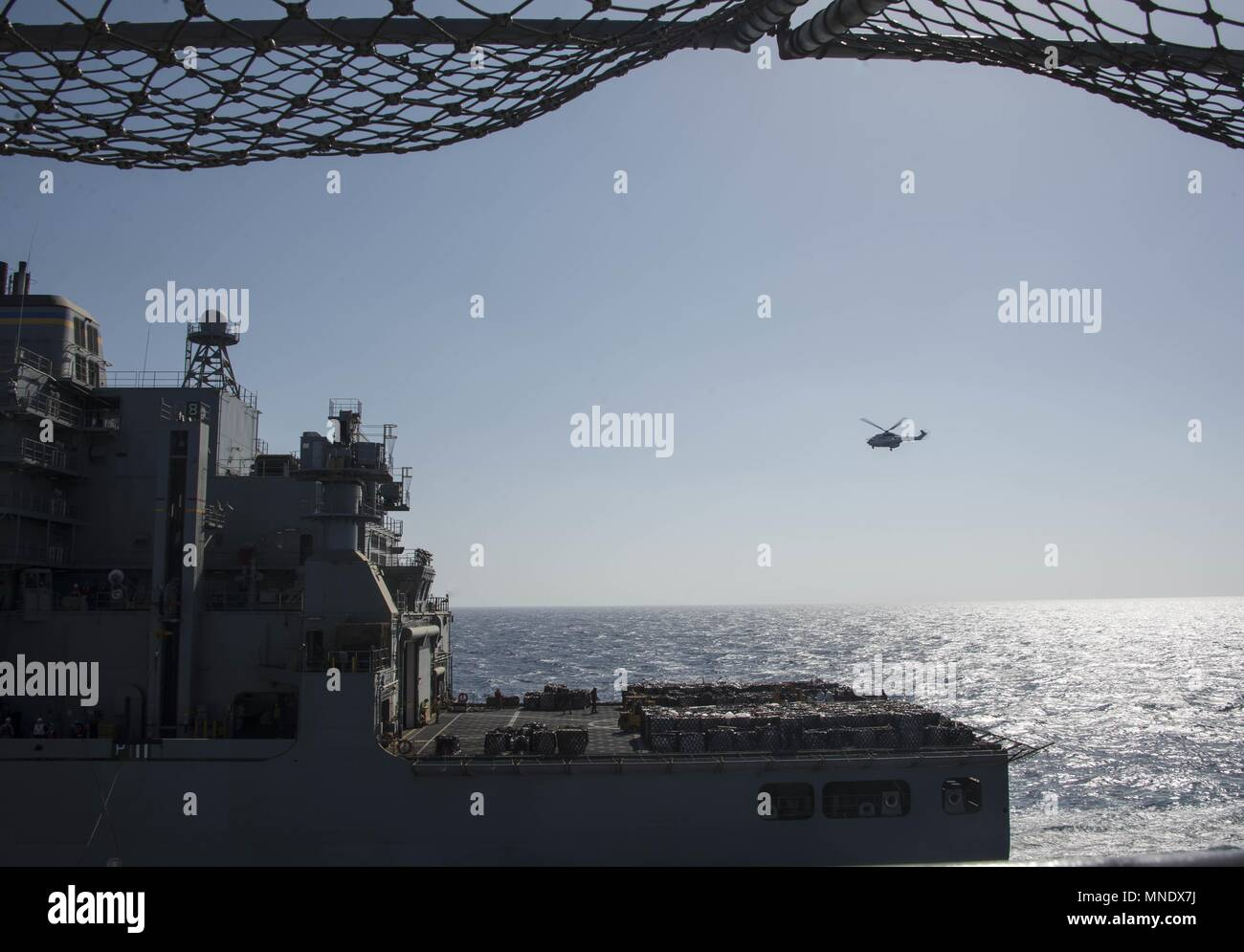 180515-N-AH771-0095 U.S. 5TH FLEET AREA OF OPERATIONS (May 15, 2018) The dry cargo and ammunition ship USNS Amelia Earhart (T-AKE 6) steadies alongside the Wasp-class amphibious assault ship USS Iwo Jima (LHD 7) during a replenishment-at-sea, May 15, 2018, May 15, 2018. Iwo Jima, homeported in Mayport, Fla. is on deployment to the U.S. 5th Fleet area of operations in support of maritime security operations to reassure allies and partners, and preserve the freedom of navigation and the free flow of commerce in the region. (U.S. Navy photo by Mass Communication Specialist 3rd Class Daniel C. Cox Stock Photo