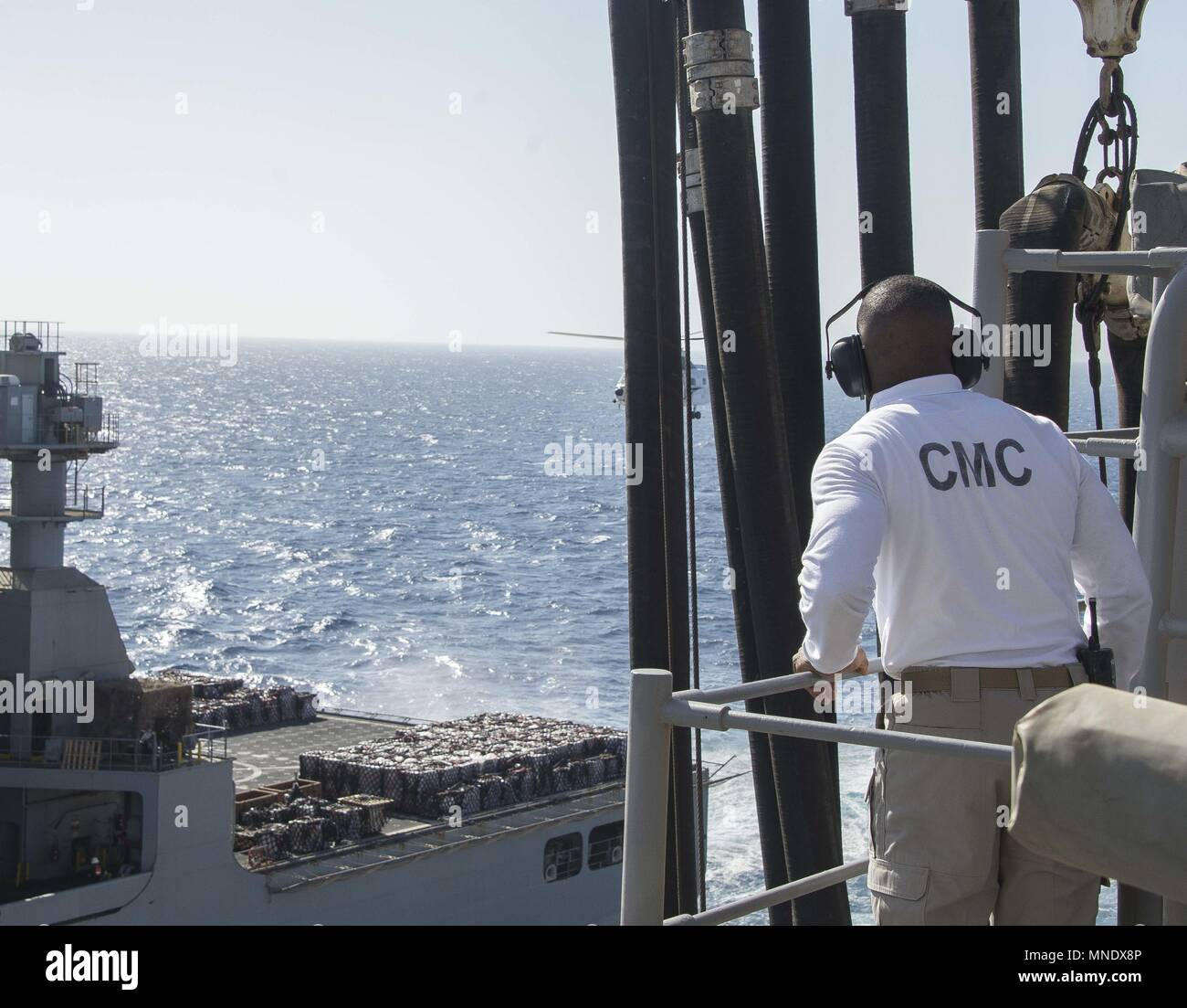 180515-N-AH771-0067 U.S. 5TH FLEET AREA OF OPERATIONS (May 15, 2018) Command Master Chief Ervin H. Byrd III, watches the dry cargo and ammunition ship USNS Amelia Earhart (T-AKE 6) come alongside the Wasp-class amphibious assault ship USS Iwo Jima (LHD 7) during a replenishment-at-sea, May 15, 2018, May 15, 2018. Iwo Jima, homeported in Mayport, Fla. is on deployment to the U.S. 5th Fleet area of operations in support of maritime security operations to reassure allies and partners, and preserve the freedom of navigation and the free flow of commerce in the region. (U.S. Navy photo by Mass Comm Stock Photo
