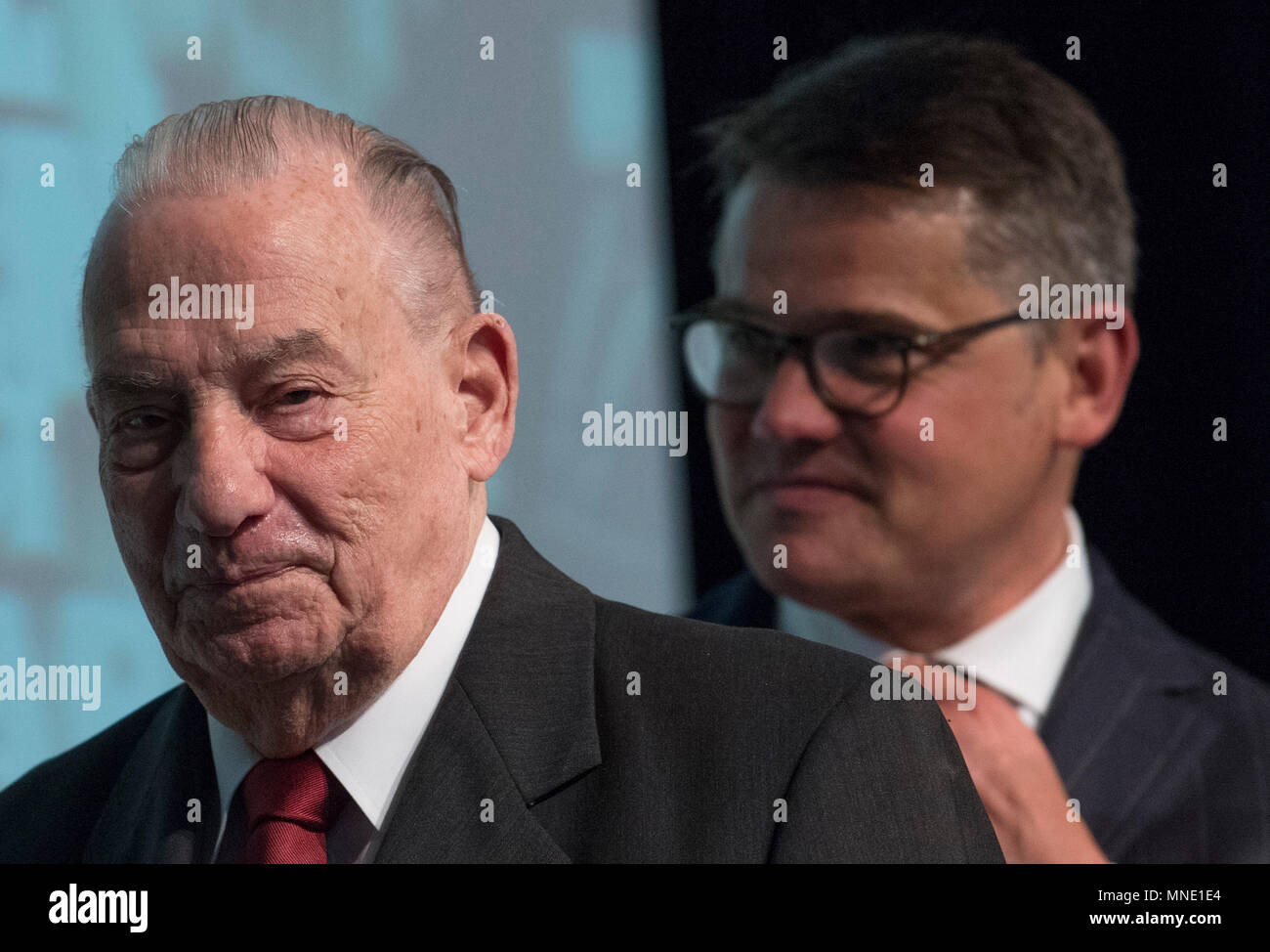 16 May 2018, Germany, Frankfurt: Hesse's Economy Minister Boris Rhein (R) of the Christian Democratic Union (CDU) and Gerhard Wiese leave the stage of the Saalbau Gallus together. Wiese is the former prosecuting counsel in the Frankfurt Auschwitz trials. The documents of the 1st Frankfurt Auschwitz trialis now a UNESCO World Heritage Document. Photo: Boris Roessler/dpa Stock Photo