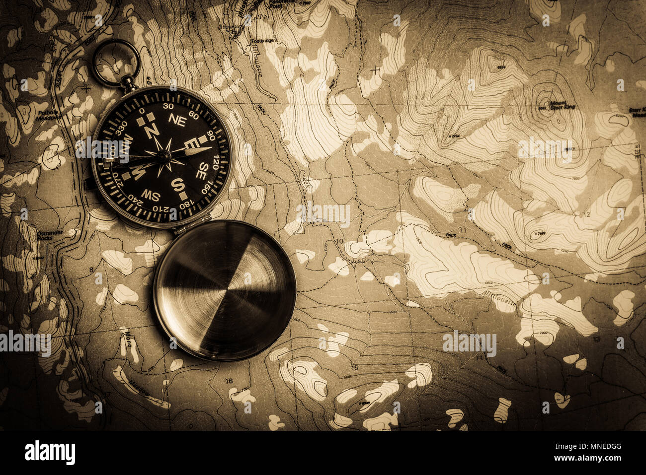 Compass on topographical map - Stock Image