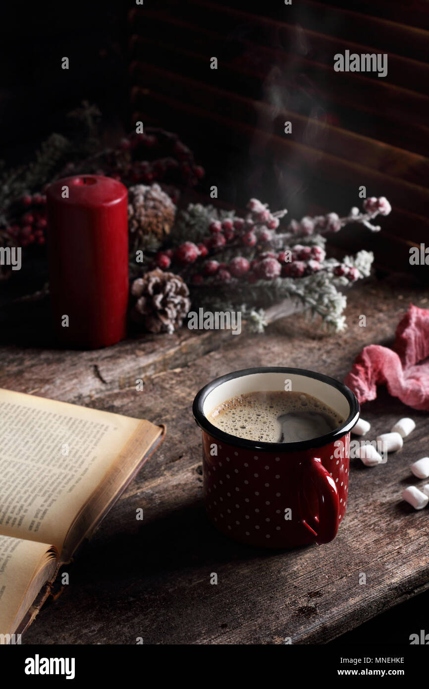 hot coffee on a wooden table, in Christmas decorations - Stock Image