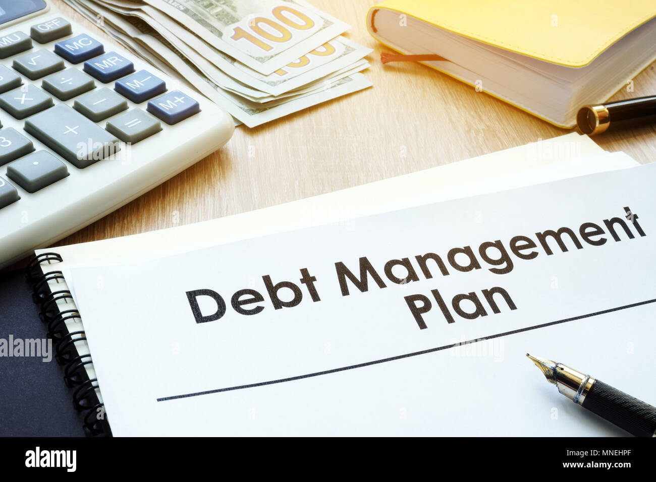 Debt Management Plan on a table. - Stock Image