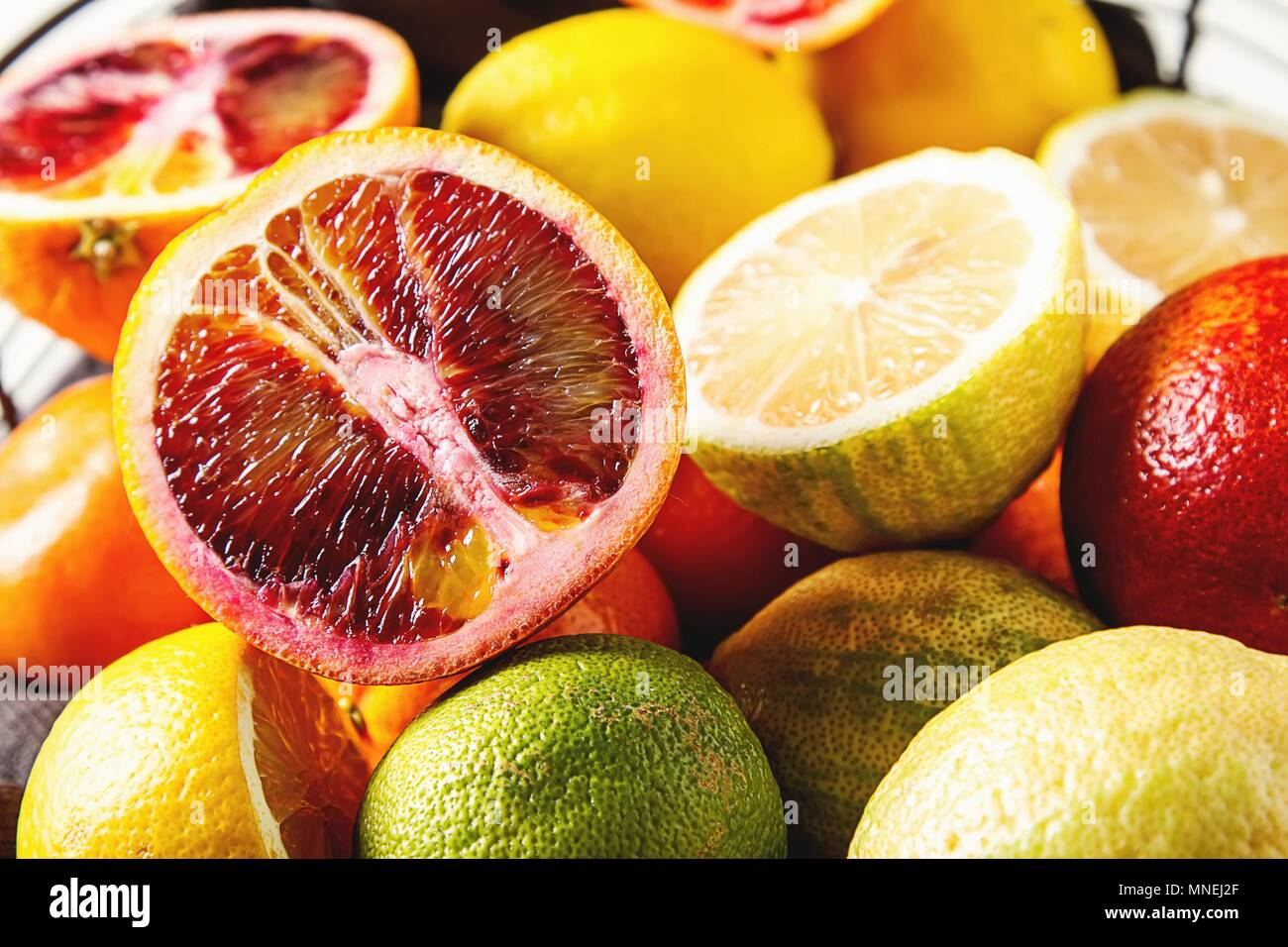 Various citrus fruit in a wire basket Stock Photo