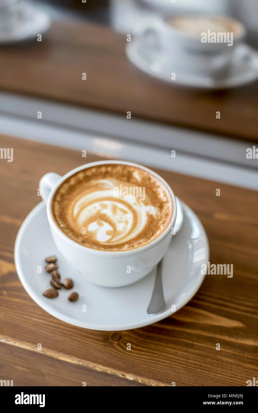 A cup of cappuccino with bulldog latte art - Stock Image