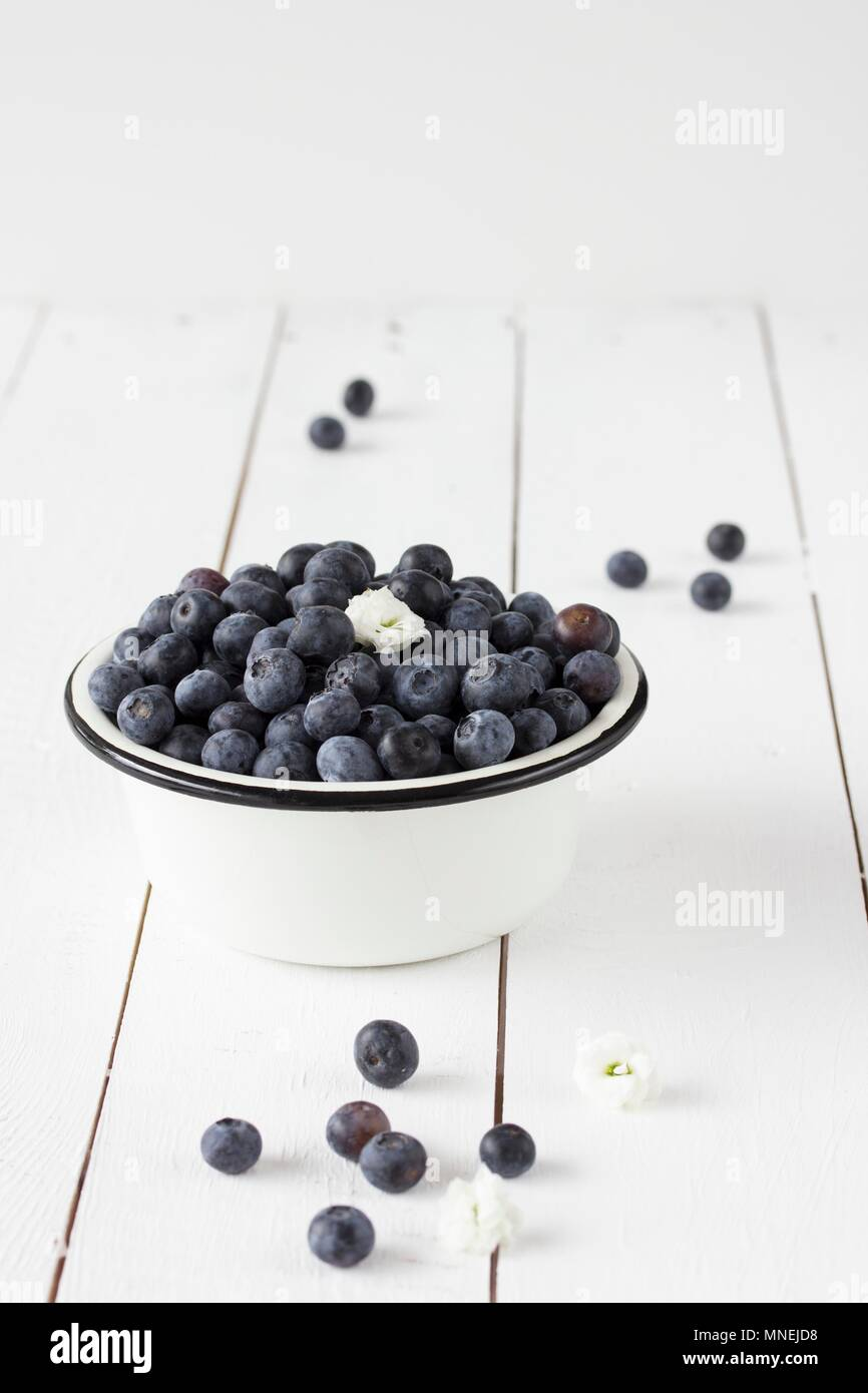 Blueberries in an enamel bowl - Stock Image