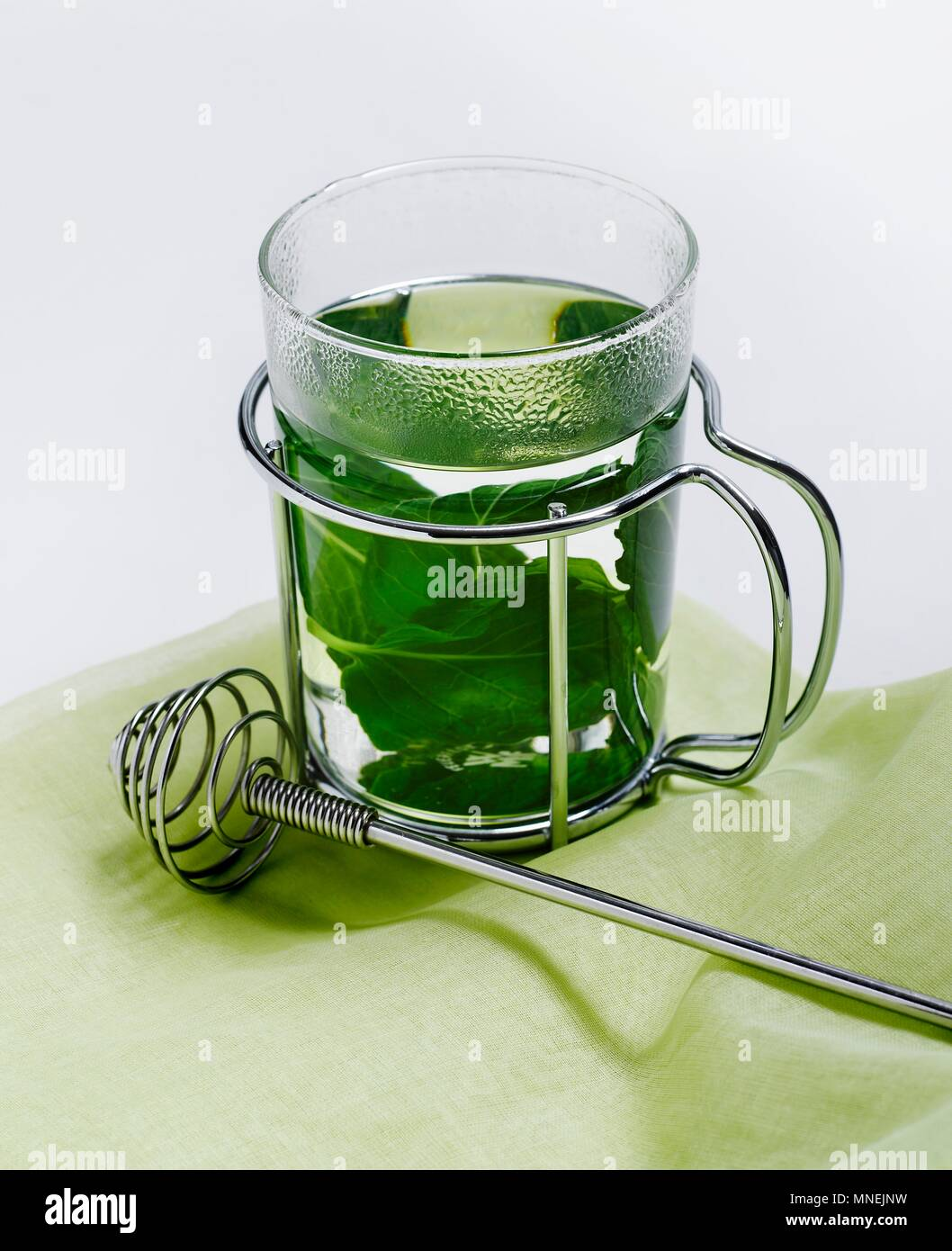 A Glass of Mint Tea with Fresh Mint Leaves - Stock Image
