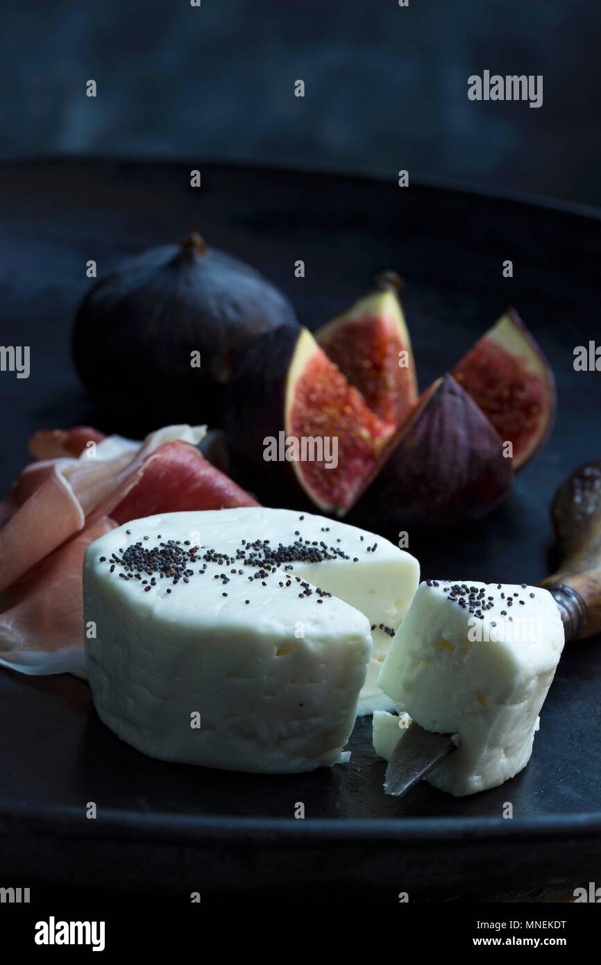 Goat's cheese, Parma ham and fresh figs as an appetiser - Stock Image