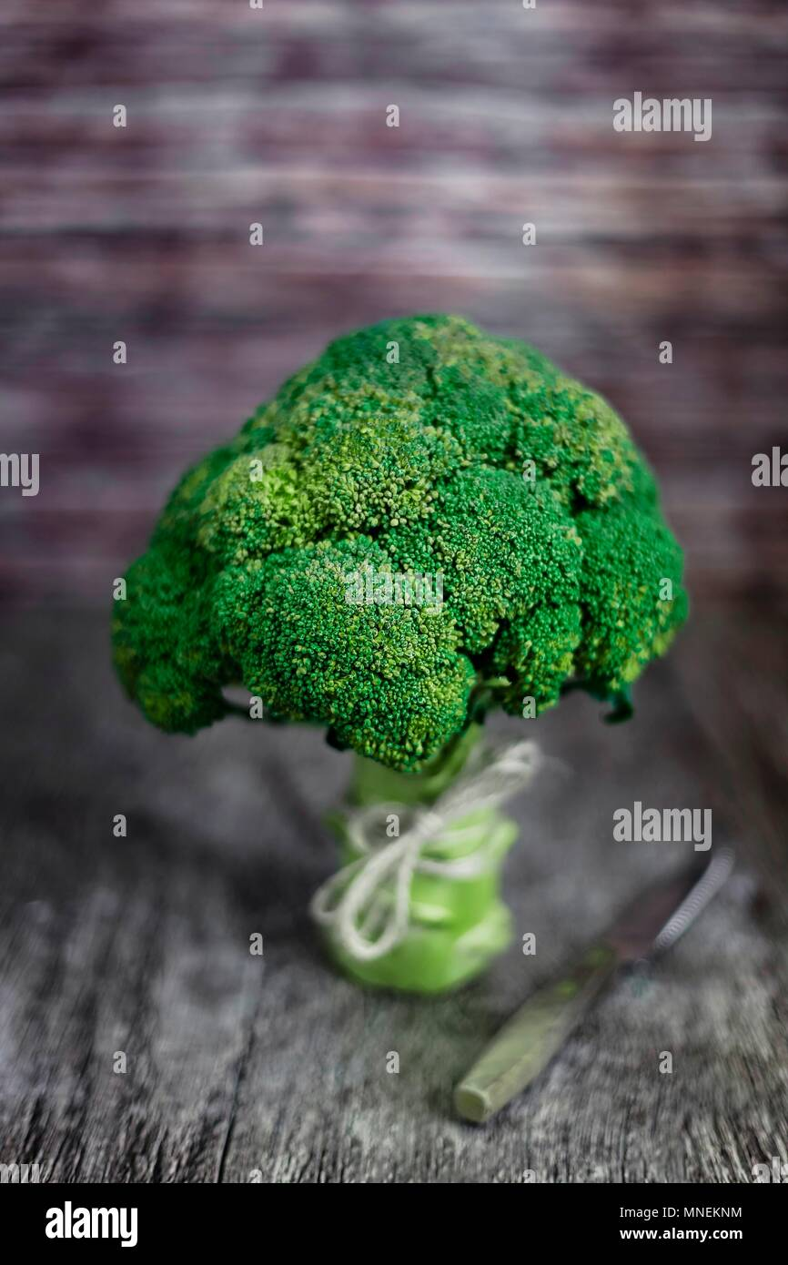 Broccoli on wooden surface - Stock Image