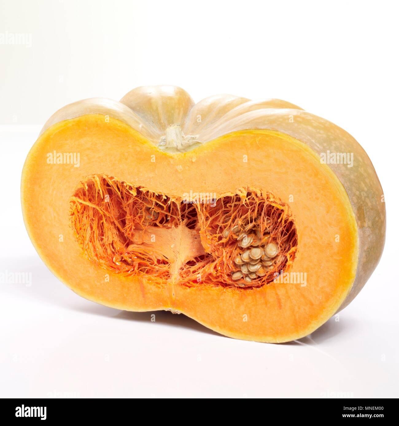 A Muscat pumpkin cut in half - Stock Image