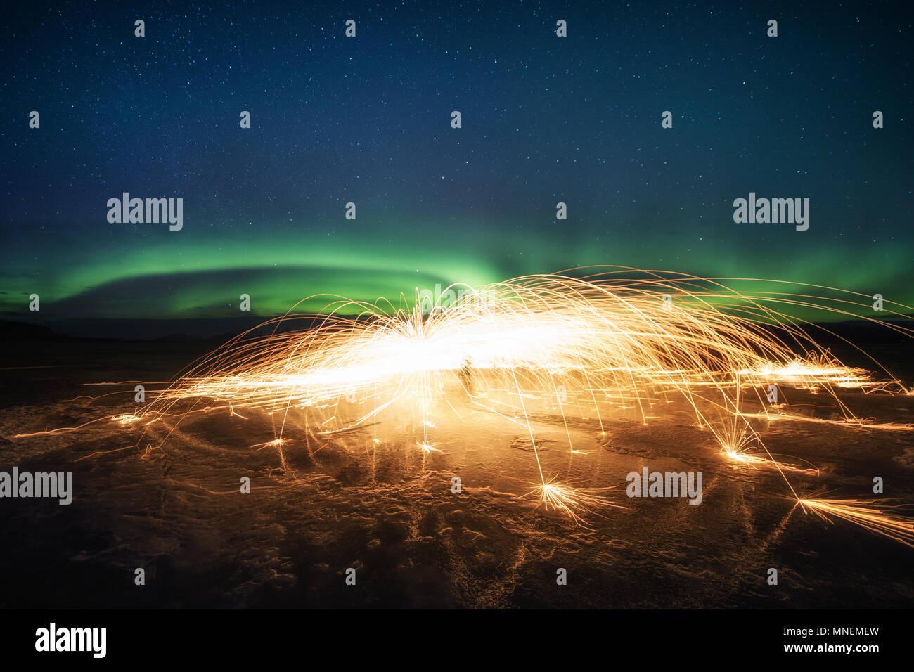 Steel wool photography aurora northern lights Yukon frozen lake night sky stars - Stock Image