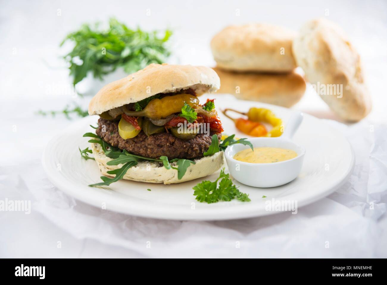 Vegan burgers with chia buns and a swede and bean patty - Stock Image