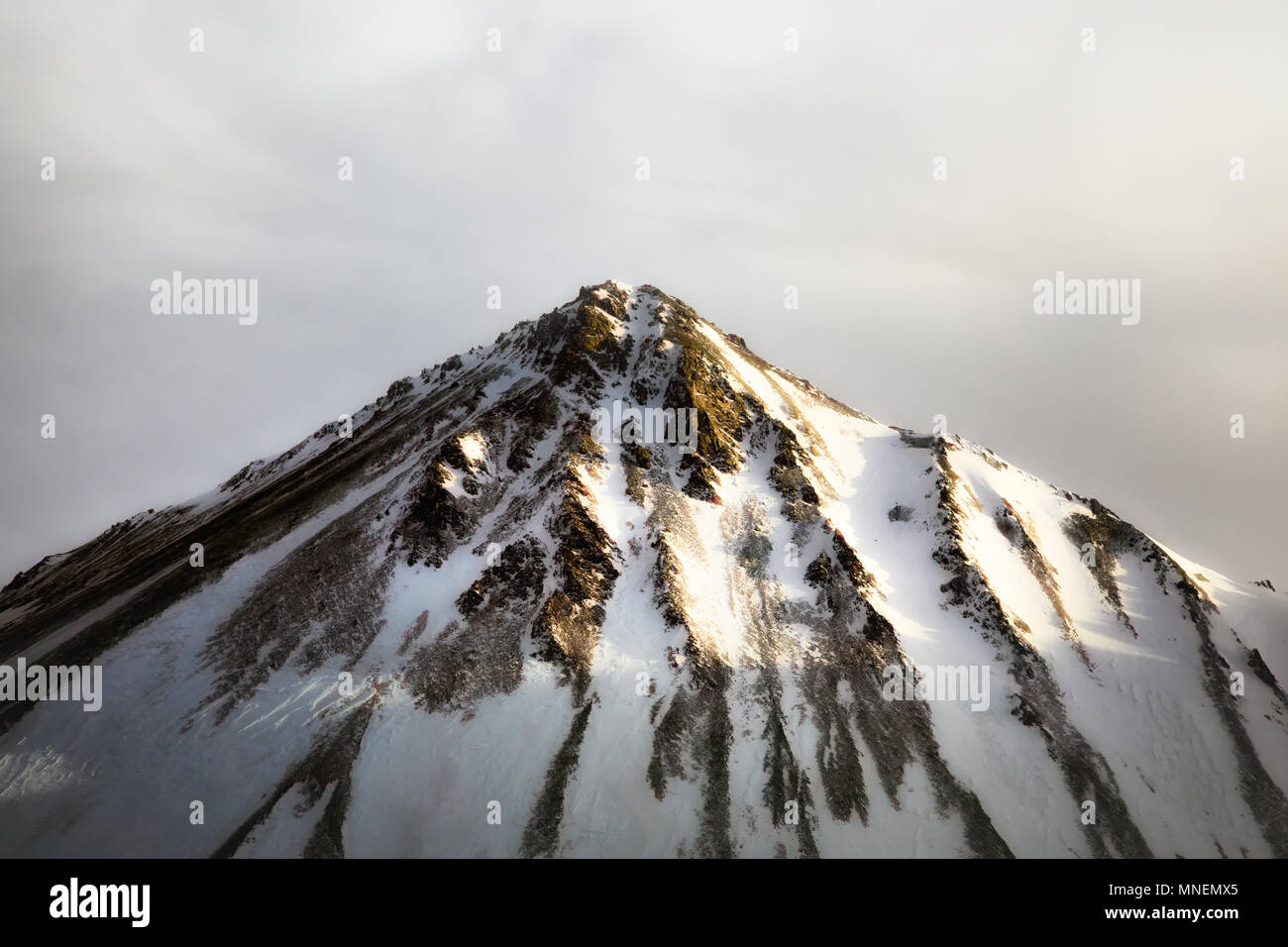 Snow winter mountain sunset peak cap Canada Yukon Stock Photo