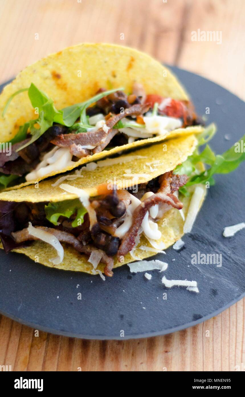 Tacos filled with meat (Mexico) - Stock Image