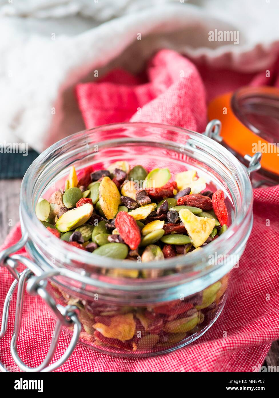 Healthy trail mix in small jar - Stock Image