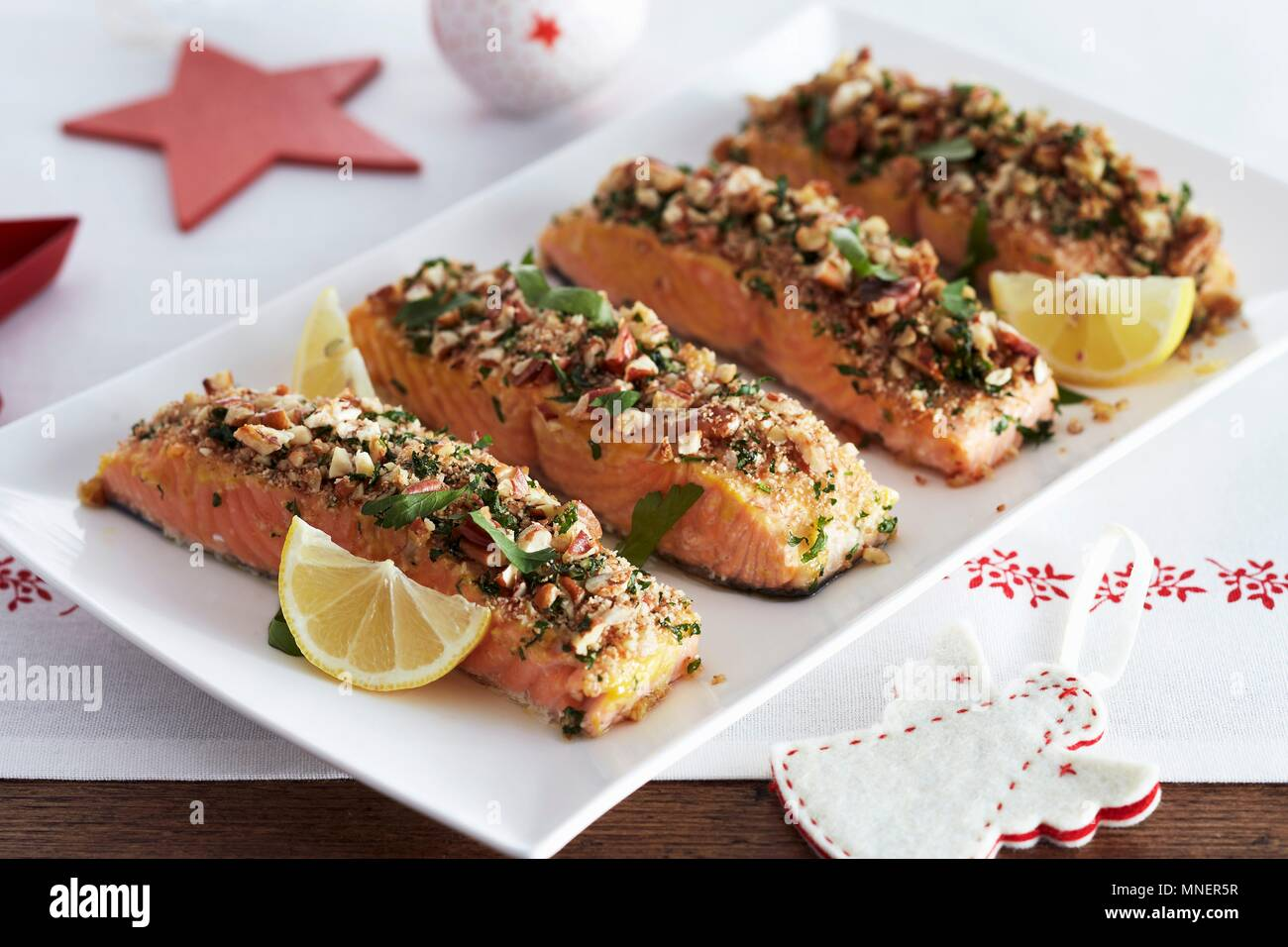 Salmon Fillets With A Nut Crust For Christmas Dinner Stock Photo