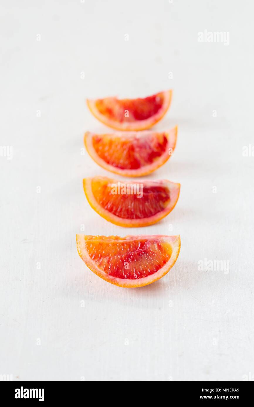 Blood orange slices in a row - Stock Image