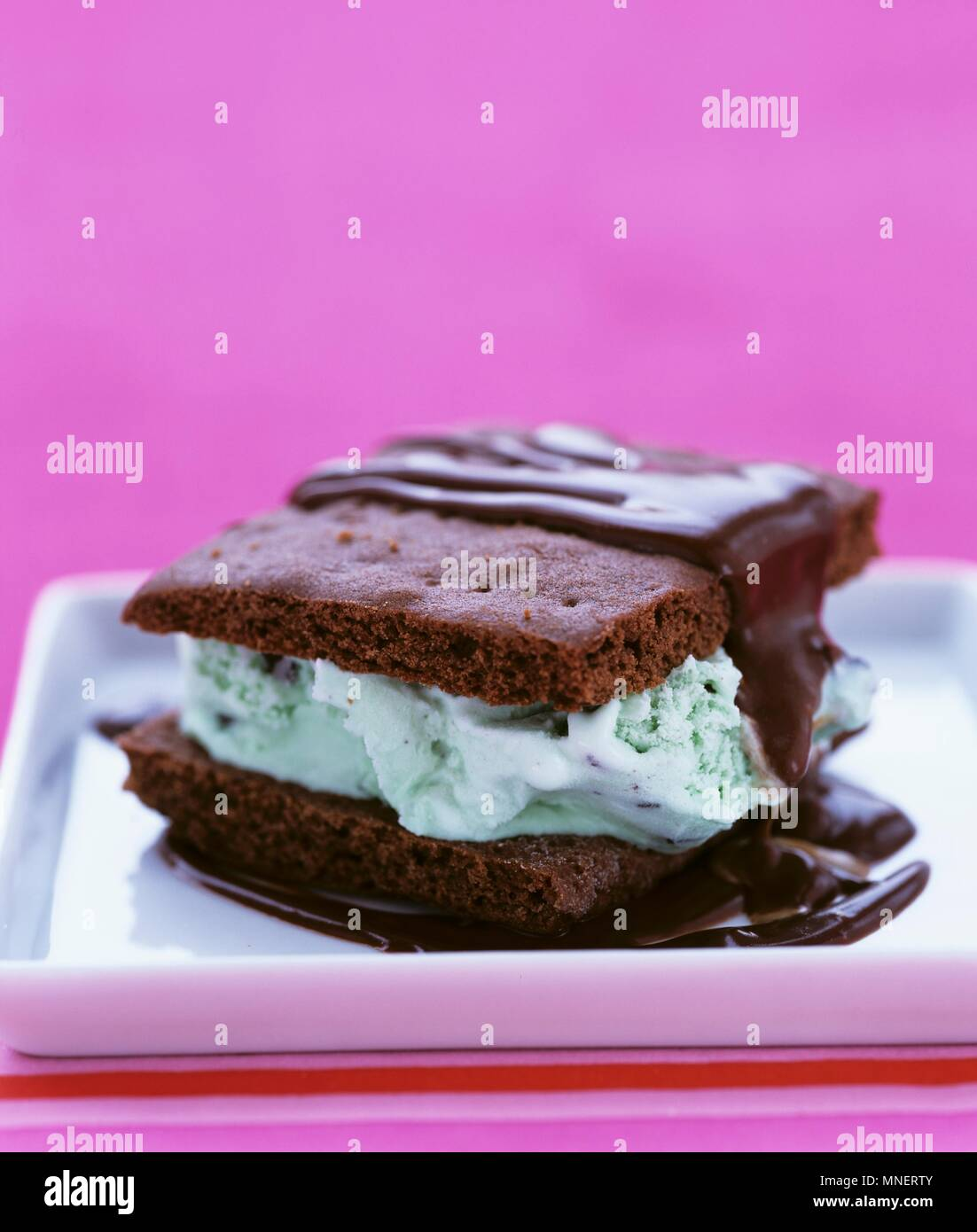 Ice cream sandwich (chocolate biscuits with mint ice cream) - Stock Image