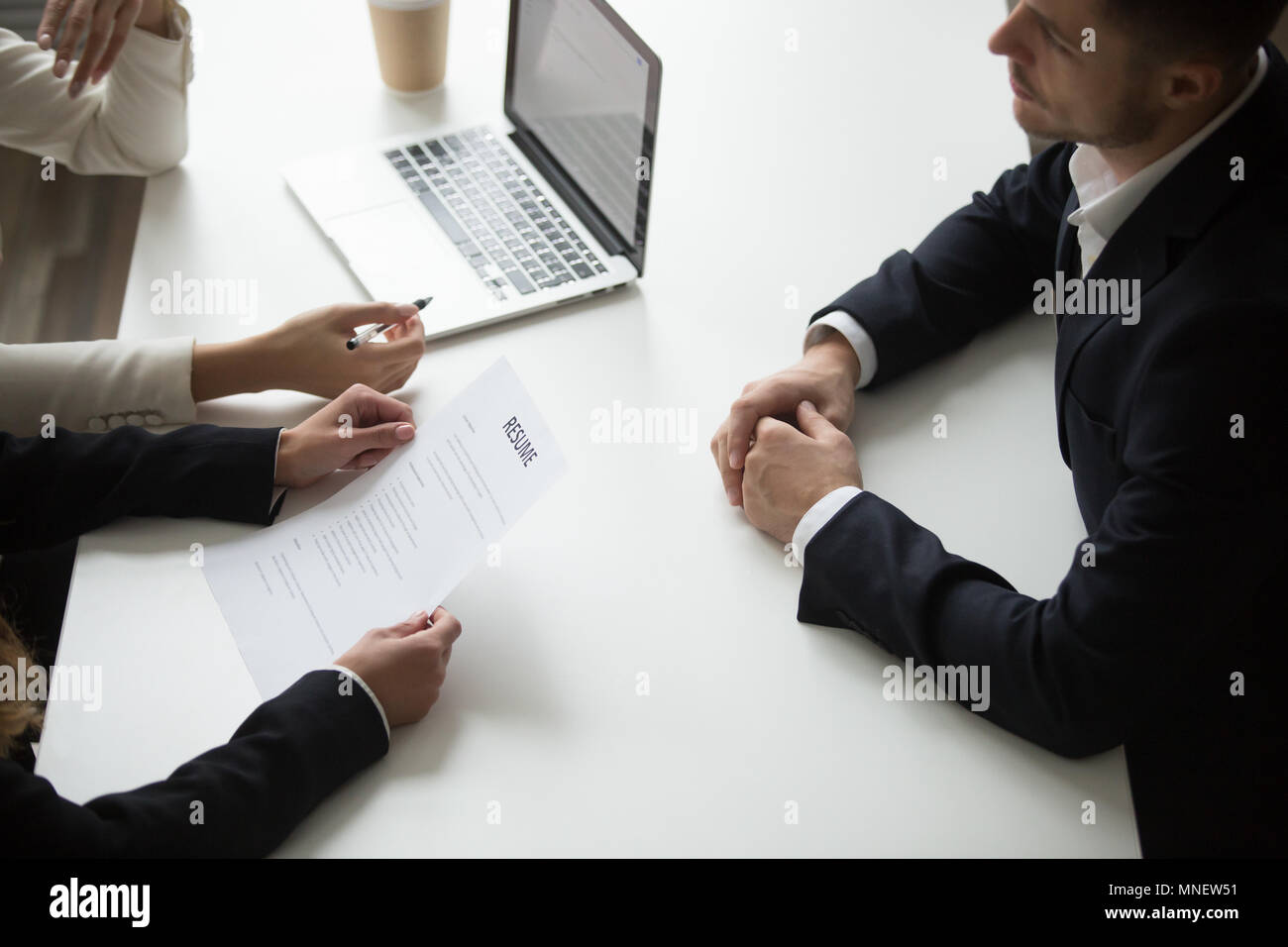 Male applicant having job interview - Stock Image