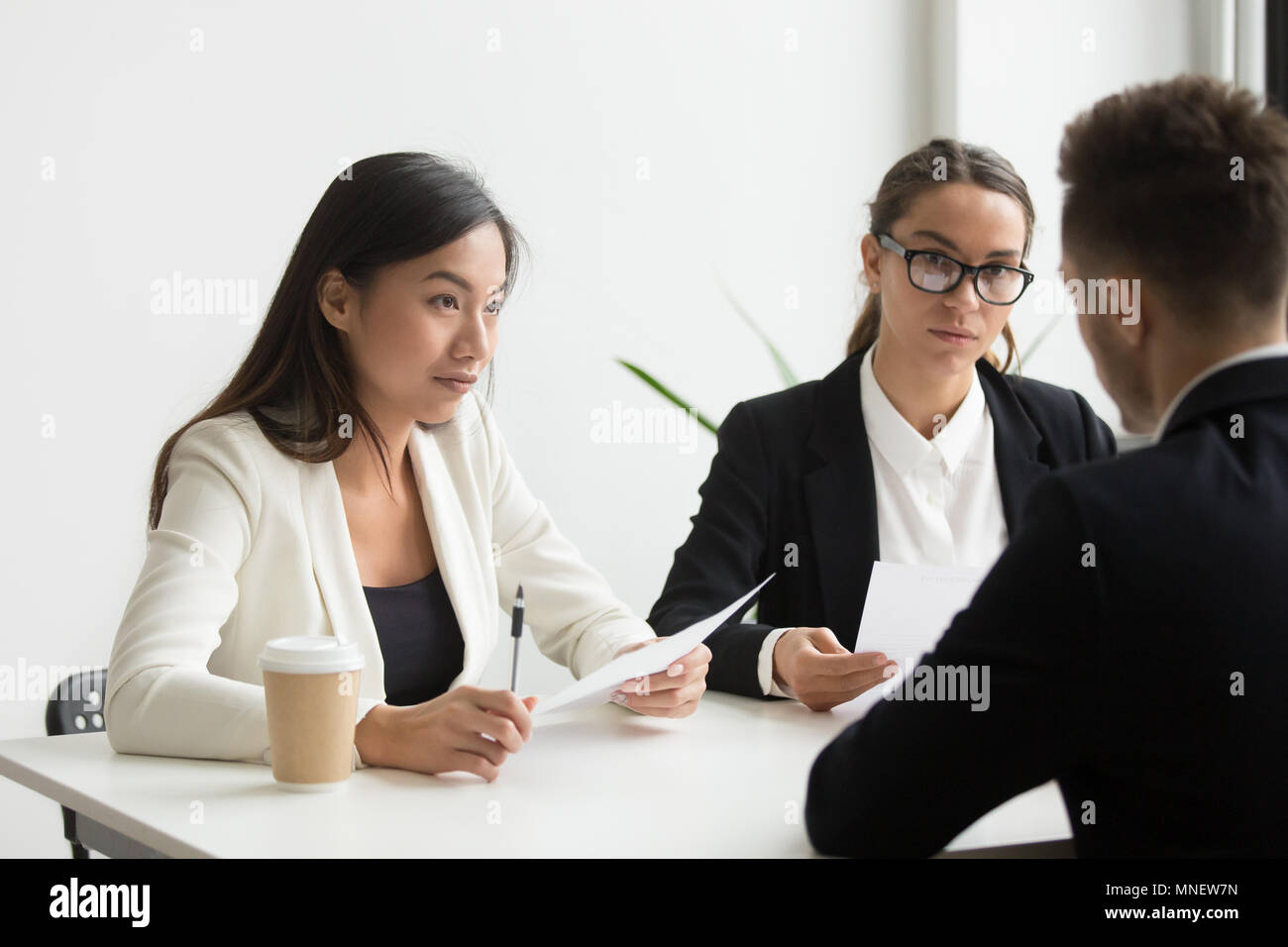 Colleagues discussing business plan in office - Stock Image