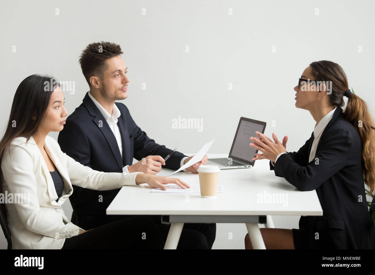Female applicant interviewed by HR mangers - Stock Image