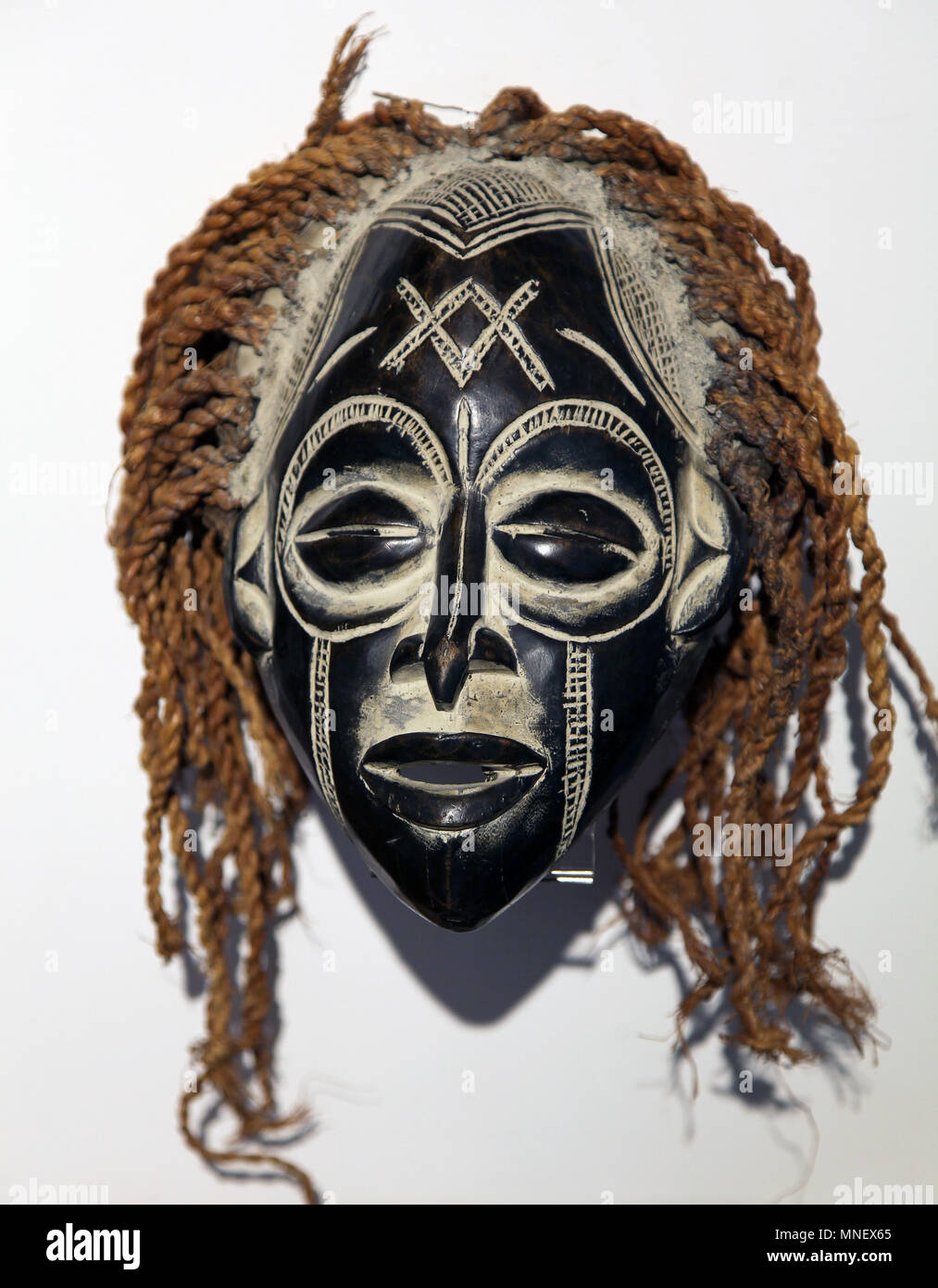 Chokwe mask from The Chokwe people aka Kioko Bajokwe Chibokwe Kibokwe Ciokwe Cokwe or Badjok.found in Angola Democratic Republic of Congo and Zambia. - Stock Image
